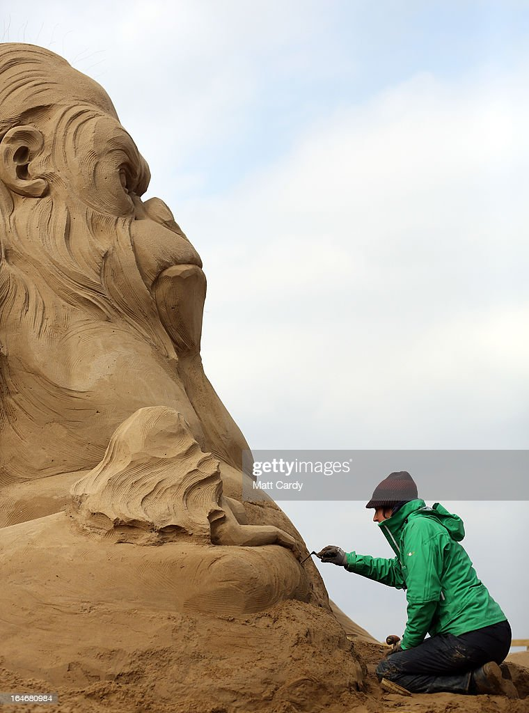 Sand sculptor Helena Bangert, from Holland works on a sand sculpture of King Kong as pieces are prepared as part of this year's Hollywood themed annual Weston-super-Mare Sand Sculpture festival on March 26, 2013 in Weston-Super-Mare, England. Due to open on Good Friday, currently twenty award winning sand sculptors from across the globe are working to create sand sculptures including Harry Potter, Marilyn Monroe and characters from the Star Wars films as part of the town's very own movie themed festival on the beach.