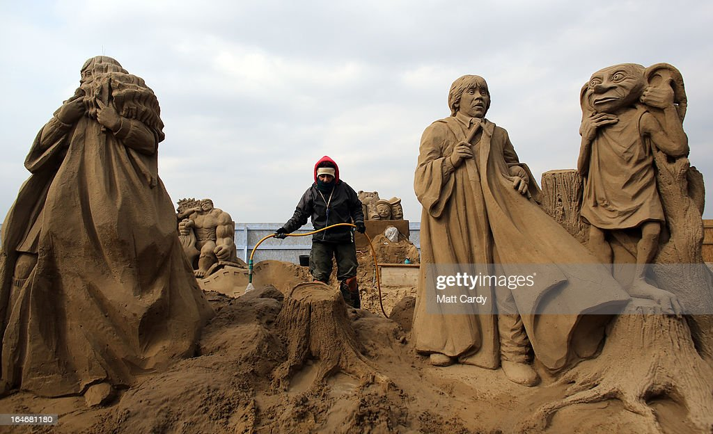 A sand sculptor works on a Harry Potter themed sand sculpture as pieces are prepared as part of this year's Hollywood themed annual Weston-super-Mare Sand Sculpture festival on March 26, 2013 in Weston-Super-Mare, England. Due to open on Good Friday, currently twenty award winning sand sculptors from across the globe are working to create sand sculptures including Harry Potter, Marilyn Monroe and characters from the Star Wars films as part of the town's very own movie themed festival on the beach.