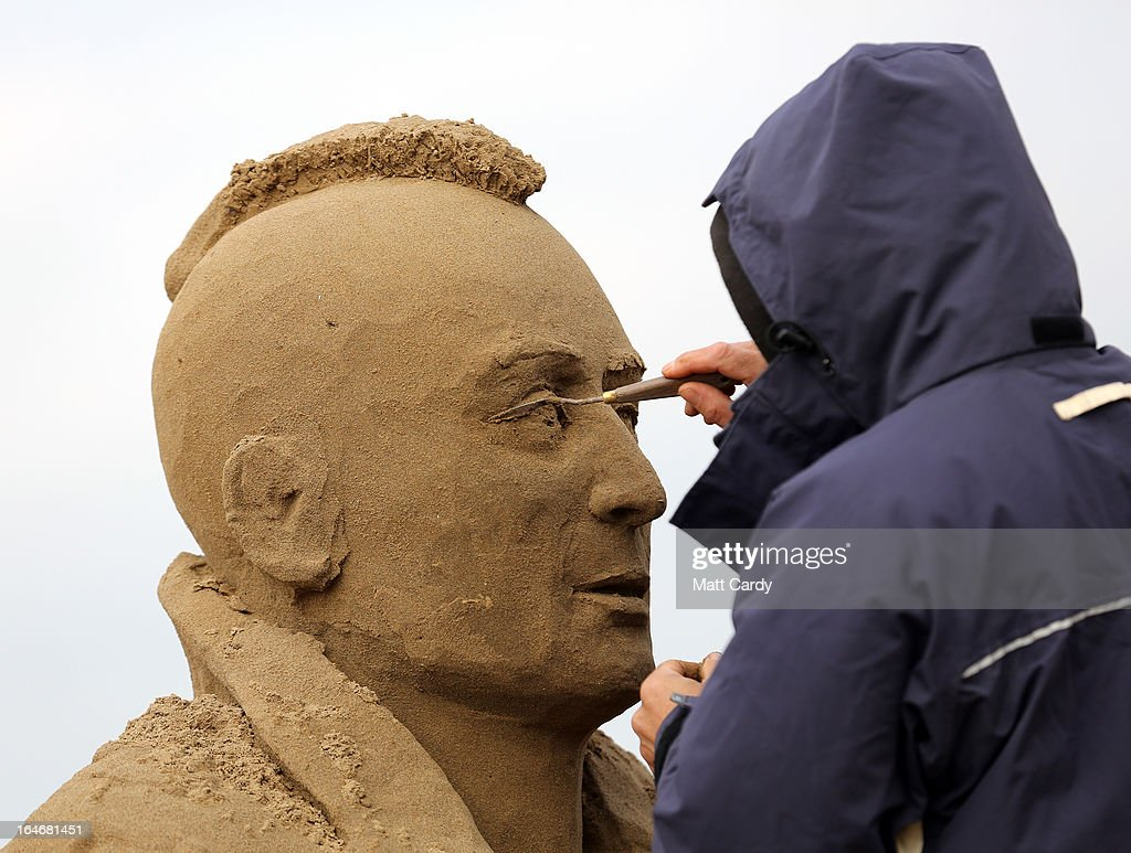 A sand sculptor works on a Robert De Niro in Taxi Driver sand sculpture as pieces are prepared as part of this year's Hollywood themed annual Weston-super-Mare Sand Sculpture festival on March 26, 2013 in Weston-Super-Mare, England. Due to open on Good Friday, currently twenty award winning sand sculptors from across the globe are working to create sand sculptures including Harry Potter, Marilyn Monroe and characters from the Star Wars films as part of the town's very own movie themed festival on the beach.