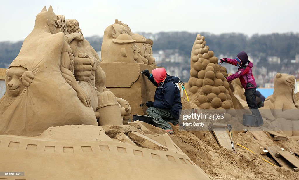 A sand sculptor works on a Toy Story themed sand sculpture as pieces are prepared as part of this year's Hollywood themed annual Weston-super-Mare Sand Sculpture festival on March 26, 2013 in Weston-Super-Mare, England. Due to open on Good Friday, currently twenty award winning sand sculptors from across the globe are working to create sand sculptures including Harry Potter, Marilyn Monroe and characters from the Star Wars films as part of the town's very own movie themed festival on the beach.