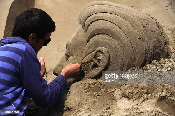 Sand sculpture artists complete sand sculptures at the annual WestonsuperMare Sand Sculpture festival on May 28 2012 in WestonSuperMare England Now...
