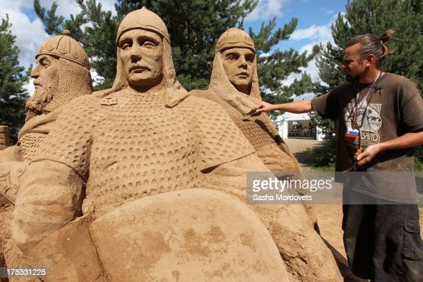 A sand sculpture of Russian President Vladimir Putin Orthodox Patriach Kirill and Prime Minister Dmitry Medvedev is made by participants of the 2013...