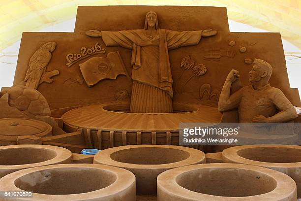 Sand sculpture of the famous Christ the Redeemer statue of Jesus Christ titled Rio 2016 Olympic at the site of Sand Museum in the Tottori Dune on...