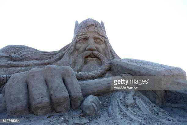 A sand sculpture of Thor Greek mythological character is being displayed during the 11th International Antalya Sand Sculpture Festival in Antalya...