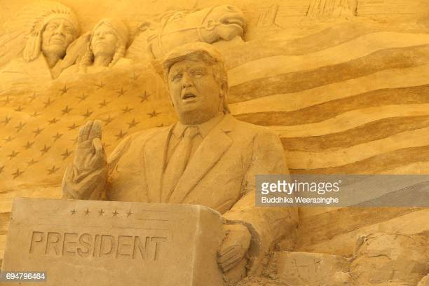 Sand sculpture of US President Donald Trump is displayed during the 10th Annual Sand Sculpture Exhibition of 'Travel Around the World in Sand The...