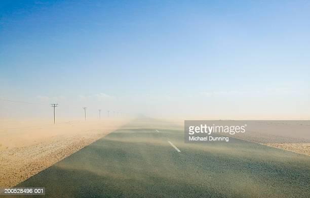 Sand storm on desert road