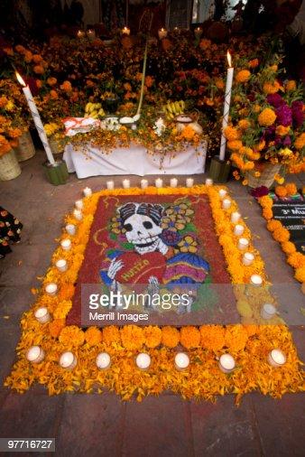 sand tapestry skeleton and altar in Zocalo plaza : Stock Photo
