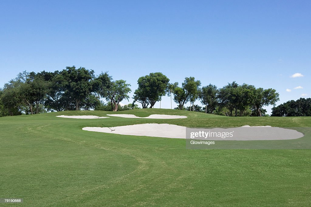 Sand trap in a golf course : Stock Photo