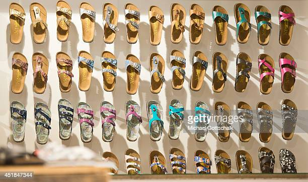 Sandals of German brand Papillion manufactured by Birkenstock are displayed at the booth of an exhibitor at the Bread and Butter trade show at the...