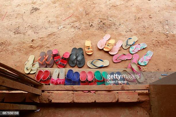 sandals outside a rural classroom
