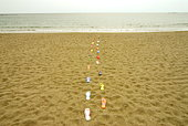 Sandals placed in lines on beach, Kamakura city, Kanagawa prefecture, Japan