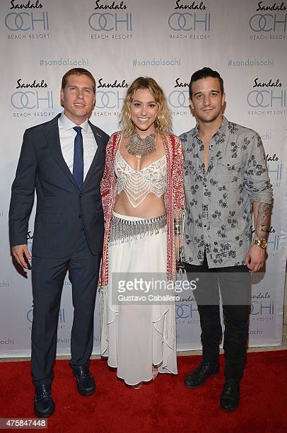 Sandals Resorts International CEO Adam Stewart poses on the red carpet with Dancing With The Stars Mark Ballas and singer/songwriter girlfriend BC...