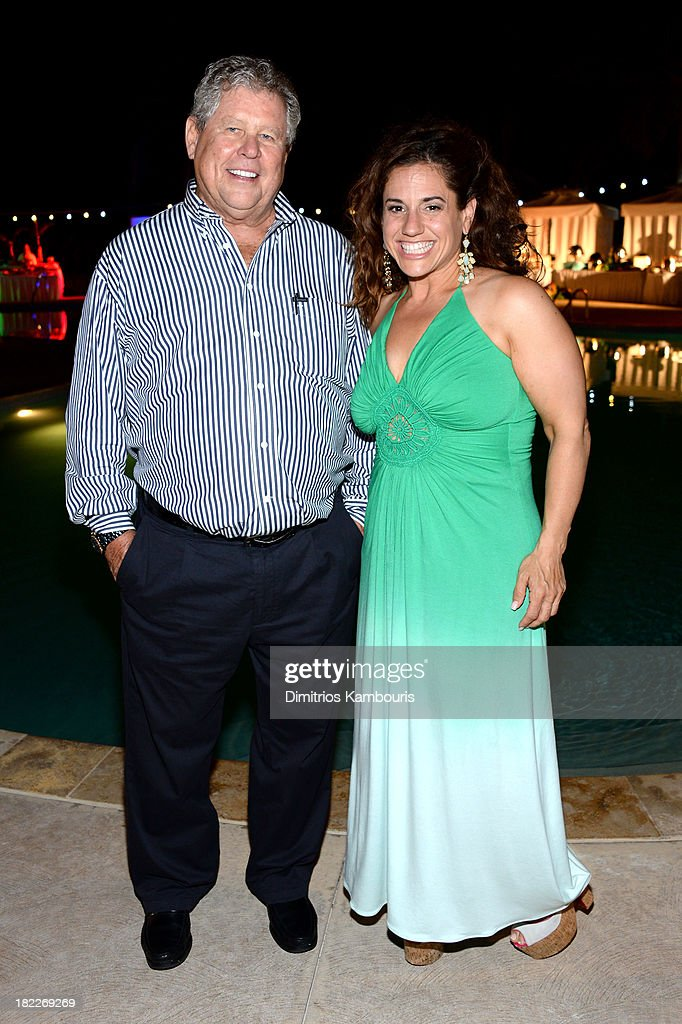 Sandals Resorts International Chairman Butch Stewart (L) and Marissa Jaret Winokur attend the Happy Hour Welcome Reception & Discovery Dining Dinner during Day Two of the Sandals Emerald Bay Celebrity Getaway And Golf Weekend on September 28, 2013 at Sandals Emerald Bay in Great Exuma, Bahamas.