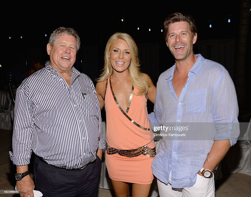 Sandals Resorts International Chairman Butch Stewart, <a gi-track='captionPersonalityLinkClicked' href=/galleries/search?phrase=Gretchen+Rossi&family=editorial&specificpeople=5637804 ng-click='$event.stopPropagation()'>Gretchen Rossi</a>, and <a gi-track='captionPersonalityLinkClicked' href=/galleries/search?phrase=Slade+Smiley&family=editorial&specificpeople=3202858 ng-click='$event.stopPropagation()'>Slade Smiley</a> attend the Happy Hour Welcome Reception & Discovery Dining Dinner during Day Two of the Sandals Emerald Bay Celebrity Getaway And Golf Weekend on September 28, 2013 at Sandals Emerald Bay in Great Exuma, Bahamas.