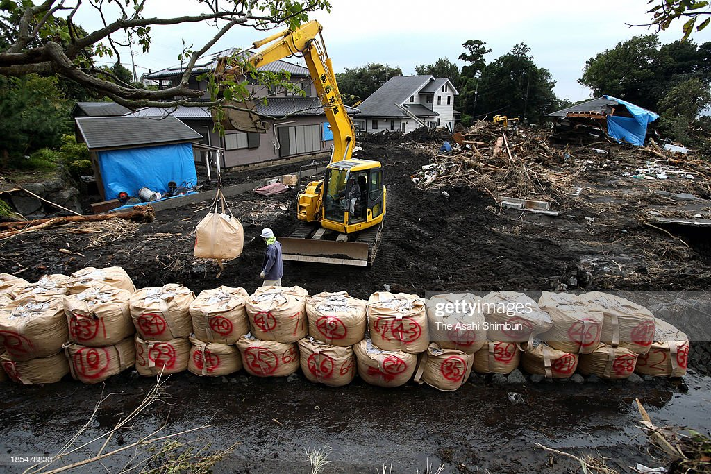 Sandbags are placed to avoid another landslides on October 19, 2013 in Oshima, Tokyo, Japan. The evacuation advisory was issued as another heavy rain was expected at a landslide devastated Oshima Island. The early morning downpours from Typhoon Wipha, or No. 26 on October 16 caused landslides that covered 1.14 million square meters and damaged or destroyed 283 homes, according to estimates by Oshima town officials.