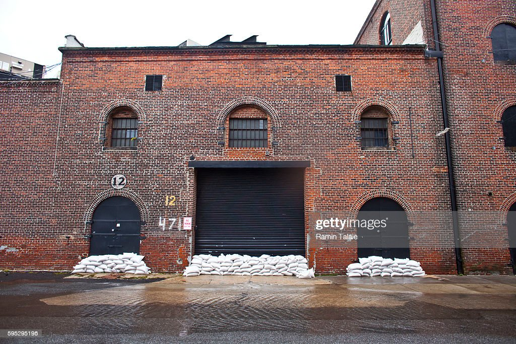 Sandbags cover the entrance of a warehouse in a flooded street in Red Hook section of Brooklyn after hurricane Irene made landfall in New York City...