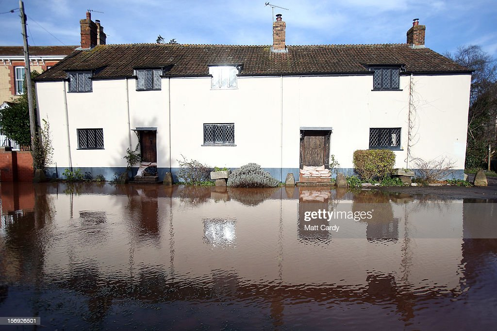 Sandbags protect a period property from flood water in the centre of the village of Ruishton, near Taunton, on November 25, 2012 in Somerset, England. Another band of heavy rain and wind continued to bring disruption to many parts of the country today particularly in the south west which was already suffering from flooding earlier in the week.