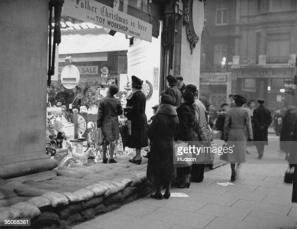 Sandbags protect a shop window at Selfridges in London during the first Christmas of World War II 16th December 1939
