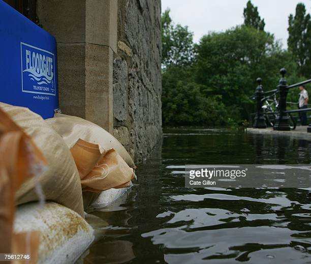 Sandbags stop the flood at the door of an office as residents review the damage after the River Thames hit suspected peak level in the early hours of...