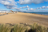 Sandbanks beach and waves Poole Dorset England UK blue sky and white clouds
