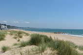 Sandbanks beach with the dunes and Bournemouth in the distance