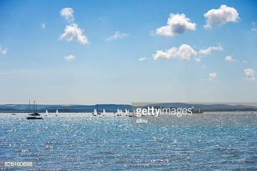 Sandbanks boats under sunshine and blue skies : Stock Photo