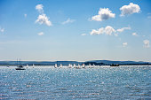 Boats race in Poole Harbour near Brownsea island