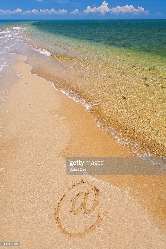 Sandbar with @ sign : Stock Photo