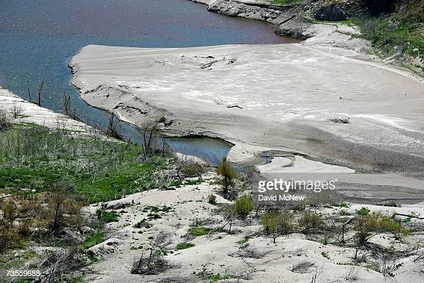 Sandbars are exposed as the Morris Reservoir water level remains dramatically low near the end of the rainy season when the waters of the San Gabriel...