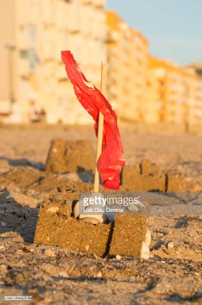 Sandcastle by the urban beach