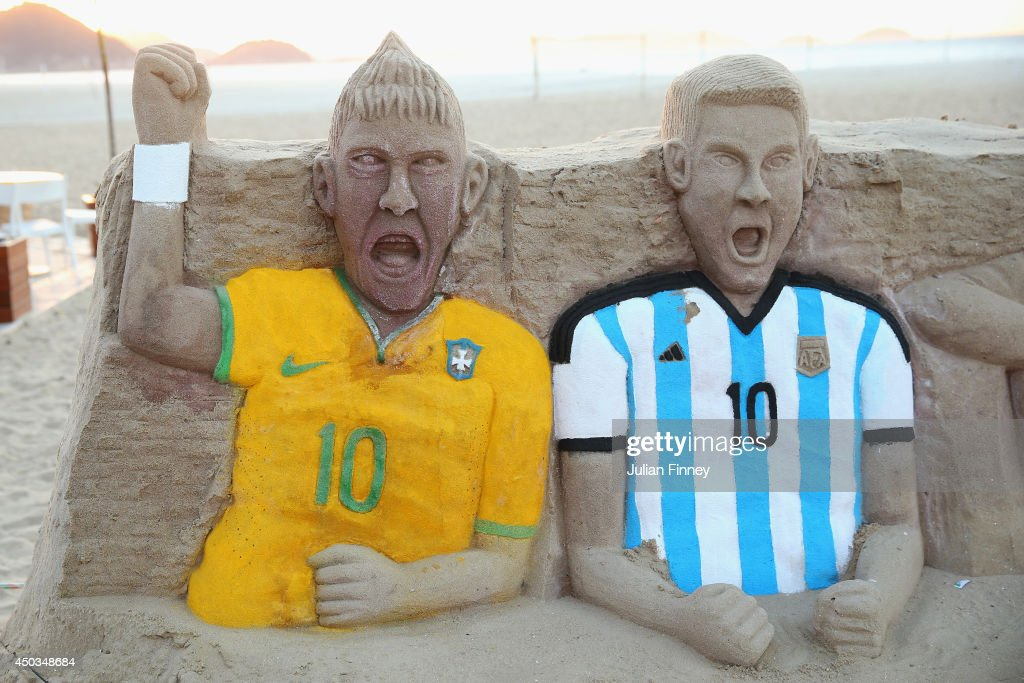 A sandcastle of Neymar of Brazil and <a gi-track='captionPersonalityLinkClicked' href=/galleries/search?phrase=Lionel+Messi&family=editorial&specificpeople=453305 ng-click='$event.stopPropagation()'>Lionel Messi</a> of Argentina on Copacabana beach on June 9, 2014 in Rio de Janeiro, Brazil.
