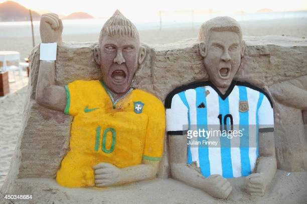 A sandcastle of Neymar of Brazil and Lionel Messi of Argentina on Copacabana beach on June 9 2014 in Rio de Janeiro Brazil