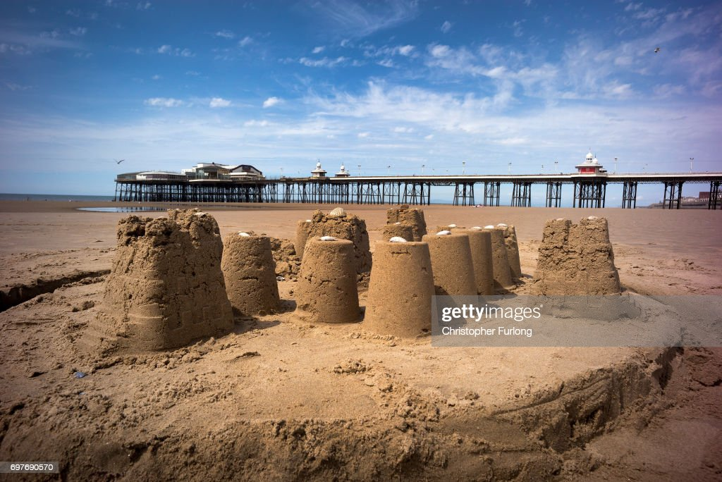 A sandcastle stands in front of Blackpool's North Pier sunshine on June 19, 2017 in Blackpool, England. The UK has officially been put on heatwave alert as the Government issued a level three amber heat warning as temperatures are set to increase. In some parts of the Uk temperatures are expected to peak at 34C.