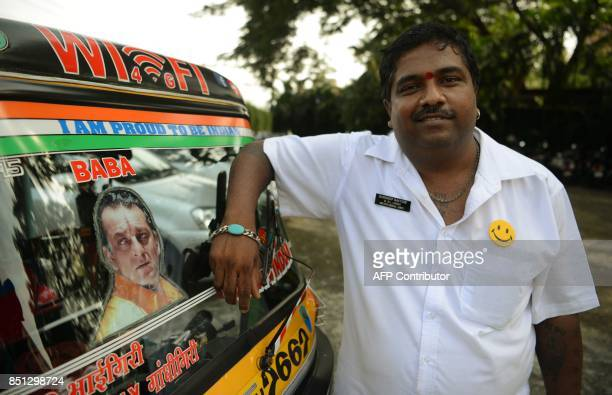 Sandeep Bachche an Indian rickshaw driver and fan of Bollywood actor Sanjay Dutt poses for a picture in Mumbai on September 22 2017 Bollywood actor...