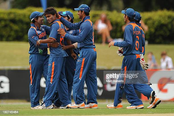 Sandeep Sharma of India celebrates a wicket with team mates during the 2012 ICC U19 Cricket World Cup Final between Australia and India at Tony...