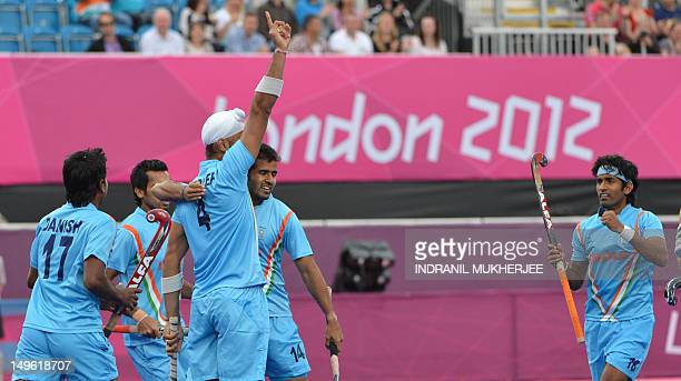 Sandeep Singh of India celebrates after scoring a goal against New Zealand during the men's field hockey preliminary round match between India and...