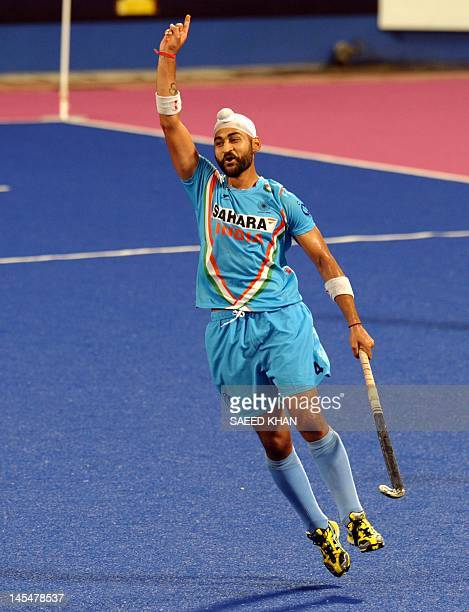 Sandeep Singh of India celebrates his first goal against Pakistan during their match at the Sultan Azlan Shah Cup men's field hockey tournament in...