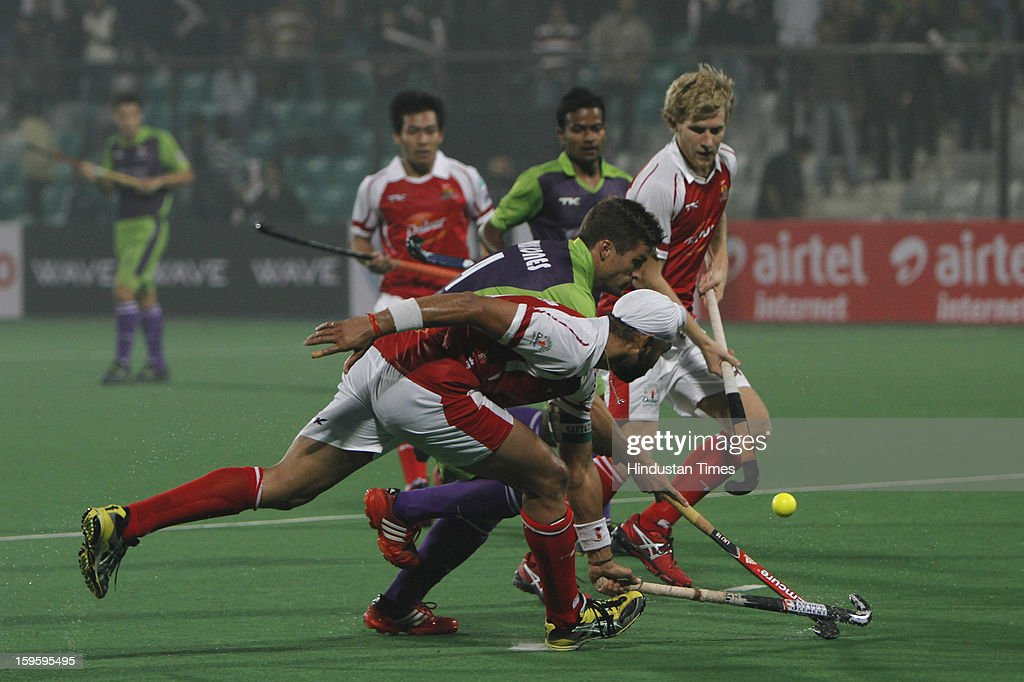 Sandeep Singh of Mumbai Magician negotiates with Delhi Waveriders players during Hockey India League match at Major Dhyan Chand National Stadium on January 16, 2013 in New Delhi, India.