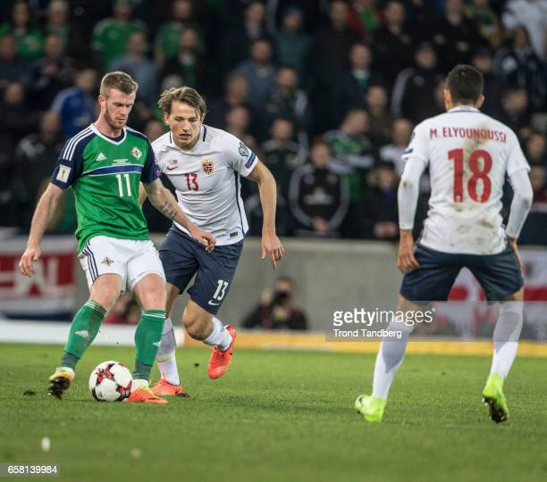 Sander Berge Mohamed Elyounoussi of Norway Chris Brunt of Northern Ireland during the FIFA 2018 World Cup Qualifier between Northern Ireland and...