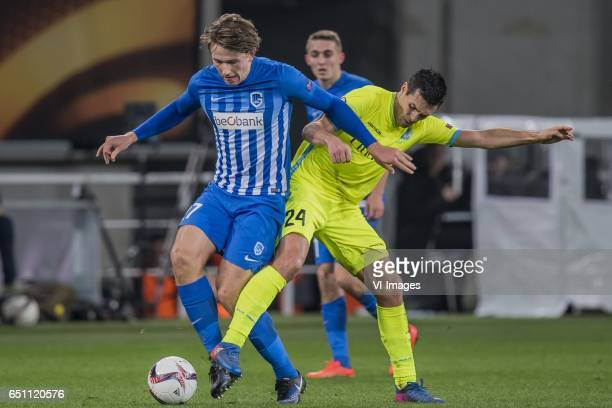 Sander Berge of KRC Genk Jeremy Perbet of KAA Gentduring the UEFA Europa League round of 16 match between KAA Gent and KRC Genk on March 09 2017 at...