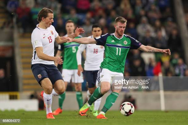 Sander Berge of Norway and Chris Brunt of Northern Ireland during the FIFA 2018 World Cup Qualifier between Northern Ireland and Norway at Windsor...