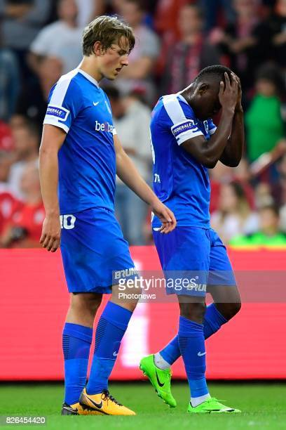 Sander Boli Berge midfielder of KRC Genk and Ally Mbwana Samatta forward of KRC Genk looking dejected on the final whistle after the defeat during...
