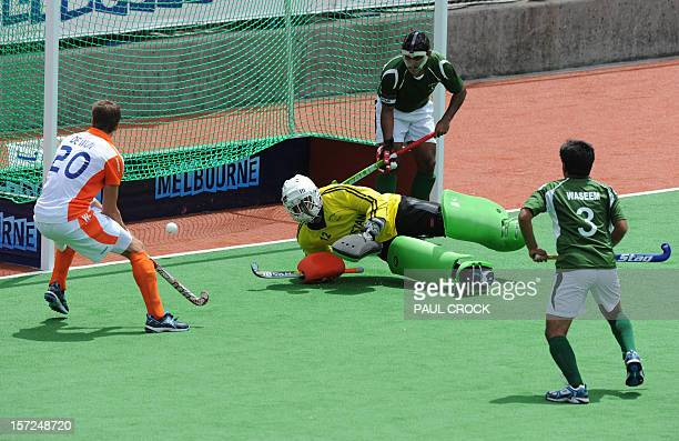 Sander de Wijn of The Netherlands watches as the ball goes past Pakistan goal keeper Imran Butt during their men's hockey match at the Champions...