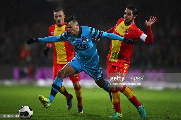 Sander Duits of Go Ahead Eagles tackles Mats Seuntjens of AZ Alkmaar during the Dutch Eredivisie match between Go Ahead Eagles and AZ Alkmaar held at...