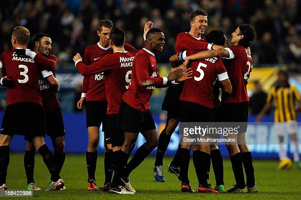 Sander Duits of RKC celebrates with team mates after the Eredivisie match between Vitesse Arnhem and RKC Waalwijk at Gelredome on December 16 2012 in...