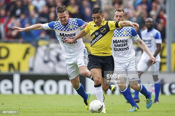 Sander Duits of RKC Waalwijk Adnane Tighadouini of NAC Breda Peter Jungschlager of RKC Waalwijk during the Dutch Eredivisie match between NAC Breda...