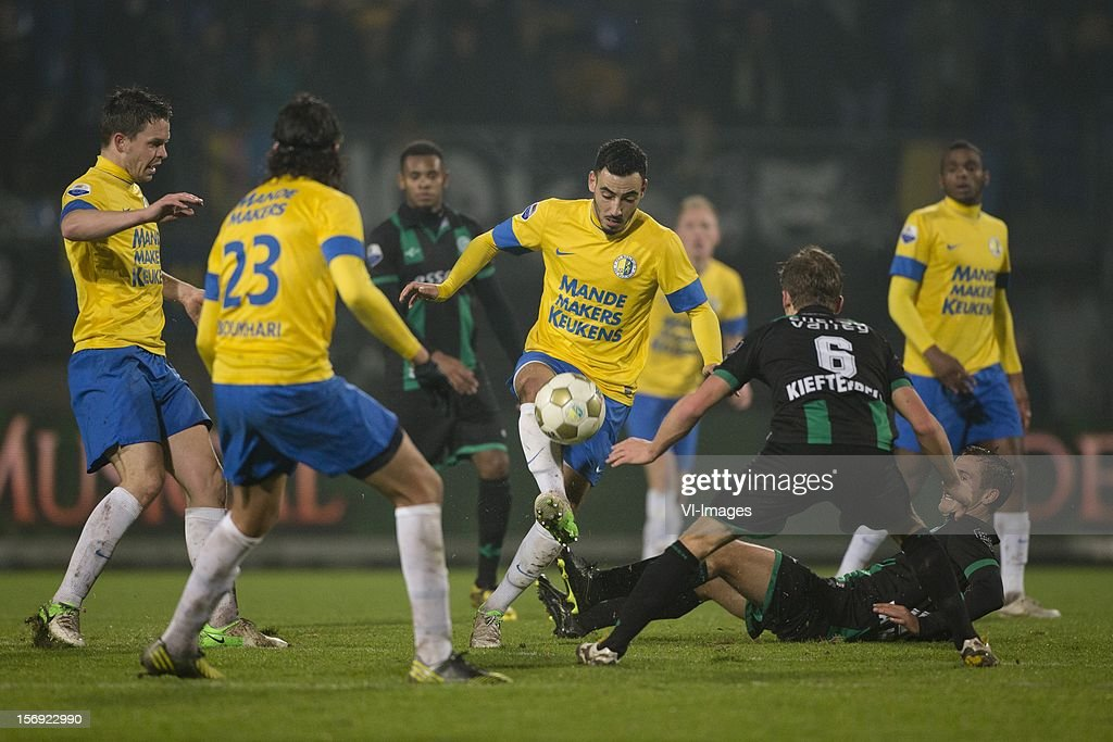 Sander Duits of RKC Waalwijk, Nourdin Boukhari of RKC Waalwijk, Imad Najah of RKC Waalwijk, Maikel Kieftenbeld of FC Groningen during the Dutch Eredivisie match between RKC Waalwijk and FC Groningen at the Mandemakers Stadium on November 24, 2012 in Waalwijk, The Netherlands.