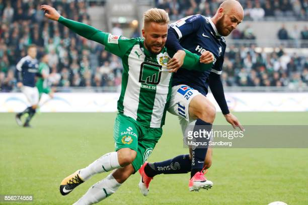 Sander Svendsen of Hammarby IF and Daniel Sjolund of IFK Norrkoping competes for the ball during the Allsvenskan match between Hammarby IF and IFK...