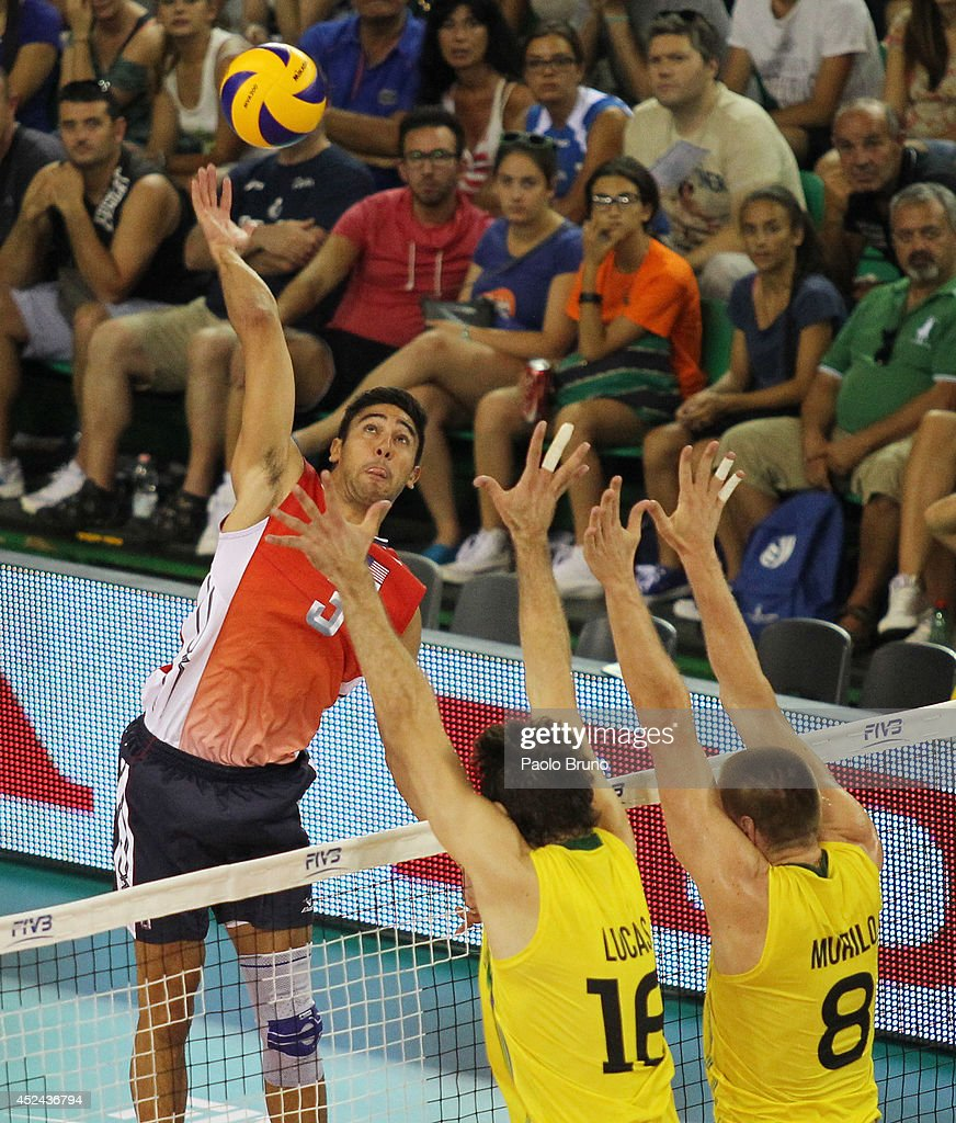 Sander Taylor of United States spikes the ball as Saatkamp Lucas with his teammate Endre Murilo of Brazil block during the FIVB World League Final Six match for the first place between United States and Brazil at Mandela Forum on July 20, 2014 in Florence, Italy.