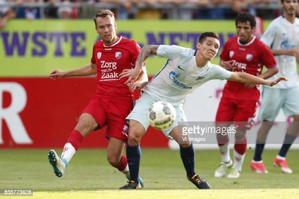 Sander van der Streek of FC Utrecht Matias Kranevitter of FC Zenit during the UEFA Europa League fourth round qualifying first leg match between FC...